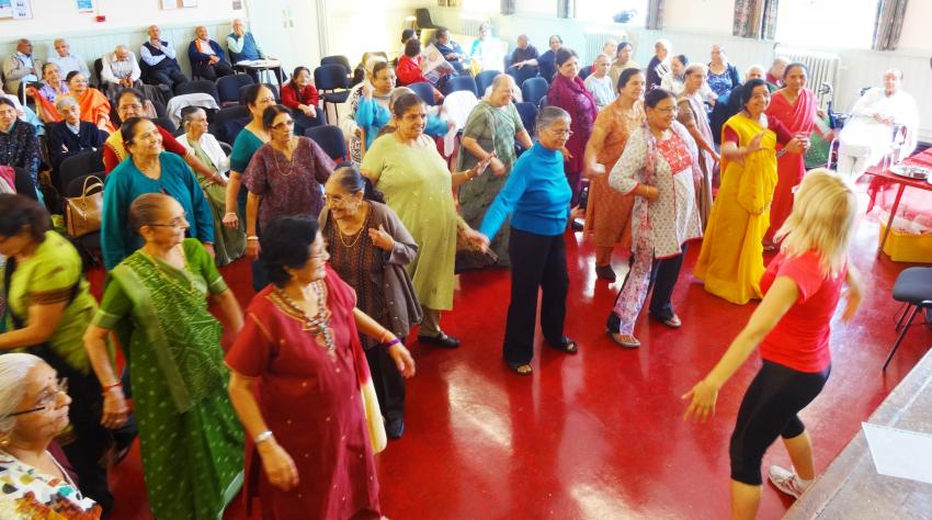 Women exercise at a community group