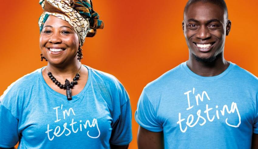 "African man and woman in T shirts with slogan ""I'm testing"""