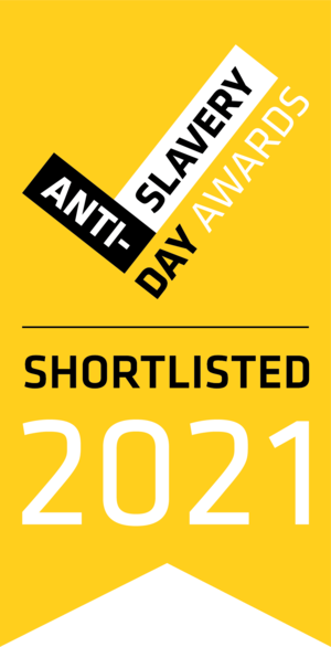 A yellow bookmark shape containing a black and white tick with the words 'anti-slavery day awards' written alongside it. Below is 'shortlisted 2021' in black and white font.