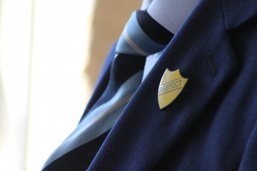 A child wearing theri school uniform