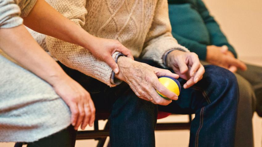 A women hand supporting and giving a caring hand to another older person