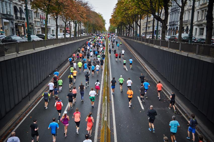A road full of people running in a race