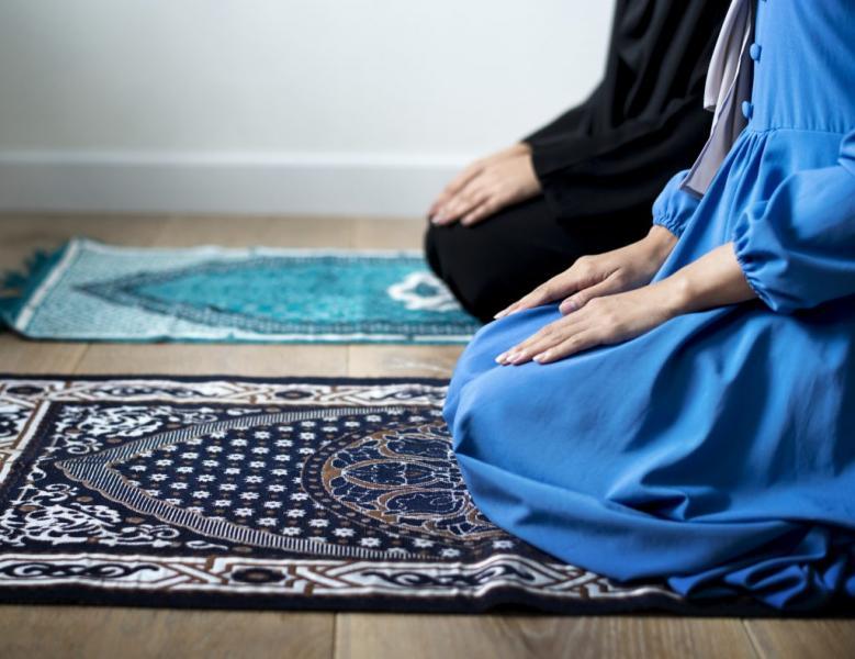 People kneel to pray