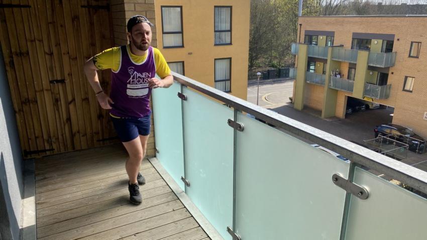 Sam Hustler running on his balcony